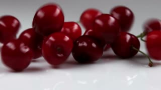 Red Cherries Falling Onto Table