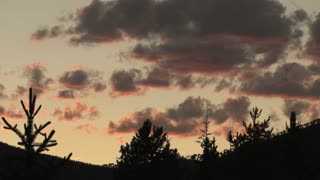 Red Sky and Colorado Mountain Silhouettes