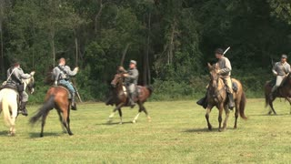 Reenactors Fighting On Horses