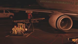 Refueling Airplane At Night