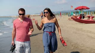 Relationship difficulties, young couple fighting on the beach, steadicam shot
