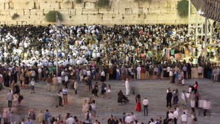Religious Jews sunset prayer service at the Western Wall, Israel timelapse. View from the top at shabbat