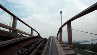 Reverse Clip of Wooden Roller Coaster Ride