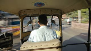 Rickshaw drivie through the Traffic congestion and street life in the City of Jaipur, Rajasthan, India