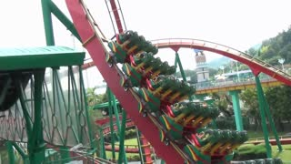Riders Fly Upside Down on Roller Coaster Loop