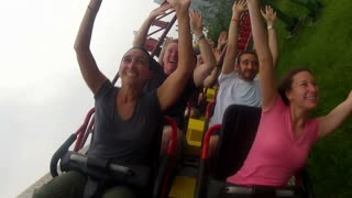 Riding Roller Coaster With Arms Up