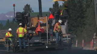 Road Crew Paving Highway In Asphalt