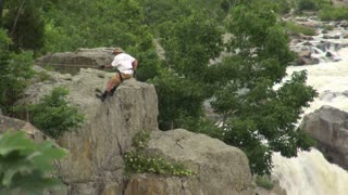 Rock Climber Beginning to Descend by River