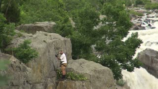 Rock Climber Descending by River