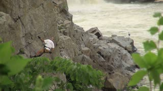 Rock Climber Rappels Out of Sight by River