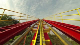 Roller Coaster Rides up Incline on Track
