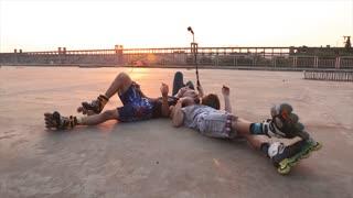 roller make selfie on bridge on sunset