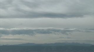 Rolling Clouds Over Hazy Mountains