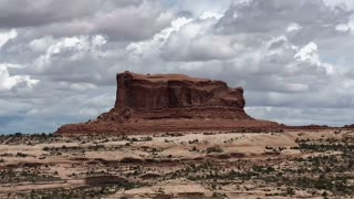 Rolling Clouds Over Sandstone Formations