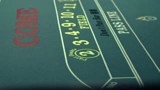 Rolling Die on Craps Table and Pushing It with Stick