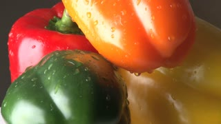Rotating Red, Orange, Yellow and Green Bell Peppers Zoomed Out