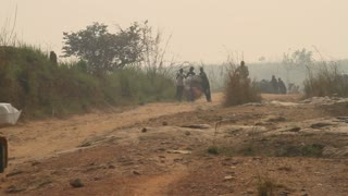 Rough Dirt African Road With Bicyclists