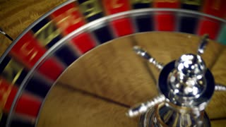 Roulette Table Spinning with Ball in Closeup Shot 2