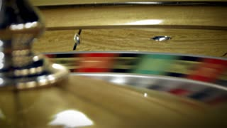 Roulette Table Spinning with Ball in Closeup Shot