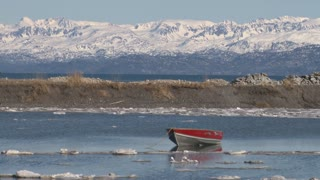 Row Boat By Snowy Mountains