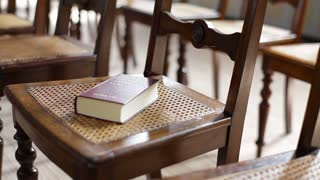 Row of Chairs in Church with Bible