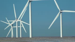Row of Wind Turbines Spinning 3