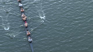 Rowing Crew Followed By Boat