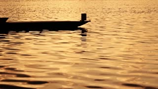 Rowing silhouettes slow motion sunset video
