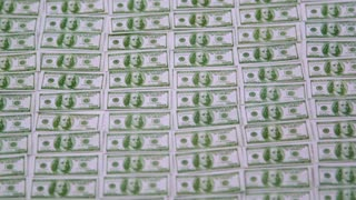 Rows of Money Blow Away