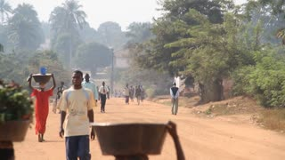 Rural African Road With People Carrying Produce On Head