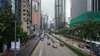 Rush hour traffic moving along Gloucester Road in Wan Chai district, Hong Kong Island, Hong Kong, China, T/lapse