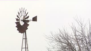 Rusty Windmill Snowing 2