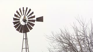 Rusty Windmill Snowing
