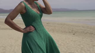 Sad woman standing alone on the beach, slow motion shot at 60fps