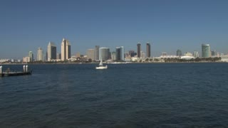 Saiboat in  harbor San Diego City Skyline across waterfront
