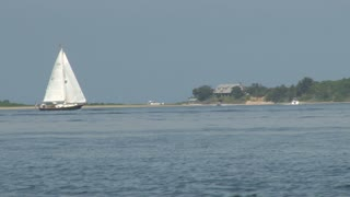 Sailboat Gliding Along Calm Bay