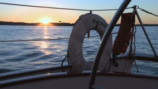 Sailboat Lifesaver and Sun Setting