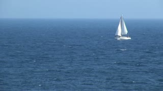 Sailboat Sailing in Ocean in Spain