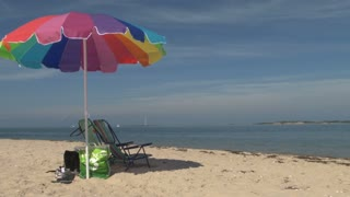 Sailboats Beach Chairs and Umbrella Scene