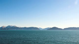 Sailing Through Mountain Range on Alaskan Waterway