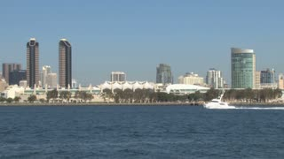 San Diego Harbor Small Yacht Sails through Skyline in Distance