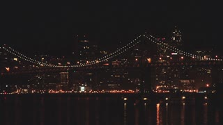 San Francisco Bay Bridge and Cityscape at Night