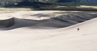 Sand boarding down Great Sand Dunes National Park