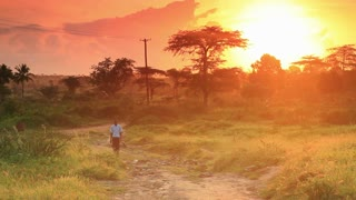 School Boy Walking at Dawn in Kenya