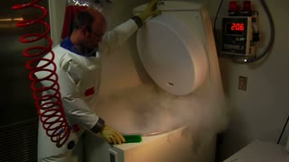 Scientists In Bubble Suit Opens Deep-freeze To Access Lab Samples
