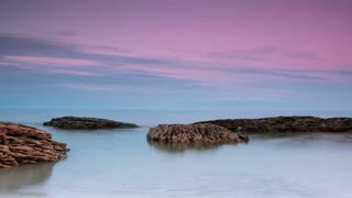 Sea and Stones after Sunset. Timelapse. 4K