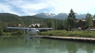 Seaplane And Houses In Beautiful Mountain Range