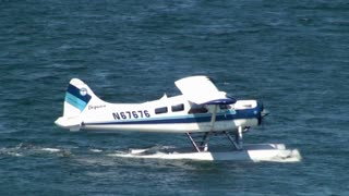 Seaplane Drifting Through Bay Water