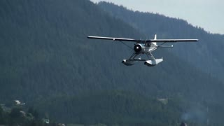 Seaplane Flying Low Across Bay