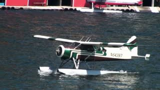 Seaplane Taking Off From Bay Water